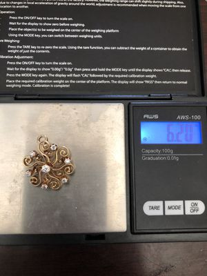 Photo 14 k diamond pendant