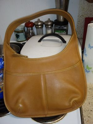 Photo All original with serial number brown leather zip-up ladies Coach purse