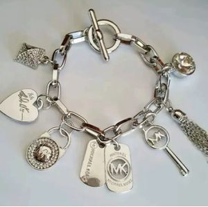 Mk Michael Kors charm bracelet jewelry for Sale in Silver Spring, MD