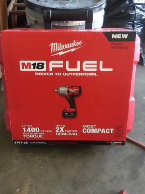 Milwaukee high torque half-inch impact wrench two batteries and charger and hard case brand new in box to 220firm for Sale in Lake Mary, FL