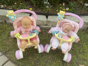 Photo Two fisher price stroll and baby dolls