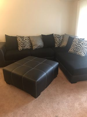 2 piece sectional with and ottoman for Sale in Oxon Hill, MD