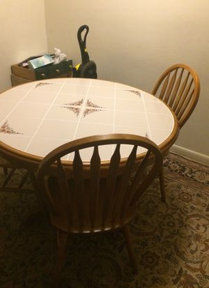 Dining table with four chairs. for Sale in Charlottesville, VA