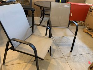 Photo Hampton Bay Mix and Match Black Steel Sling Chairs in Wet Cement color
