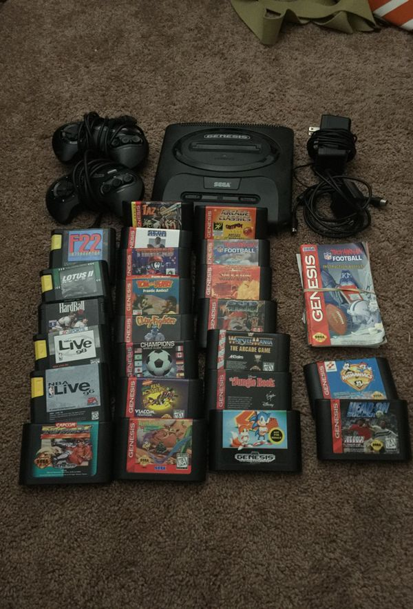 SEGA Genesis II Vintage Gaming System Model: MK-1631 with two controllers  and 23 games including Street Fighter II Special Edition and Sonic The Hedg