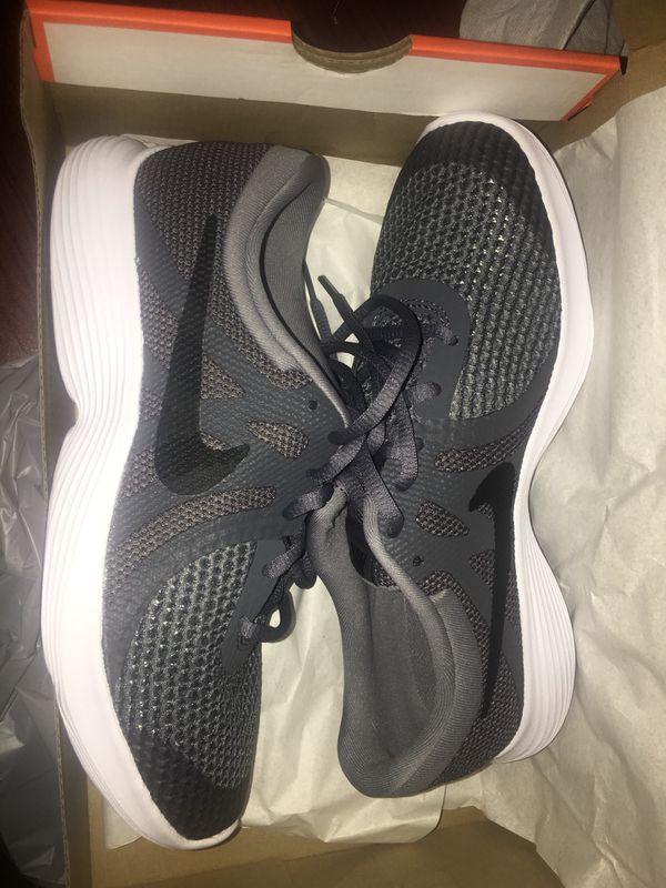966feb05c629b Nike Sport Grey Revolution GS 943309 005 Lightweight and well cushioned  running shoe.