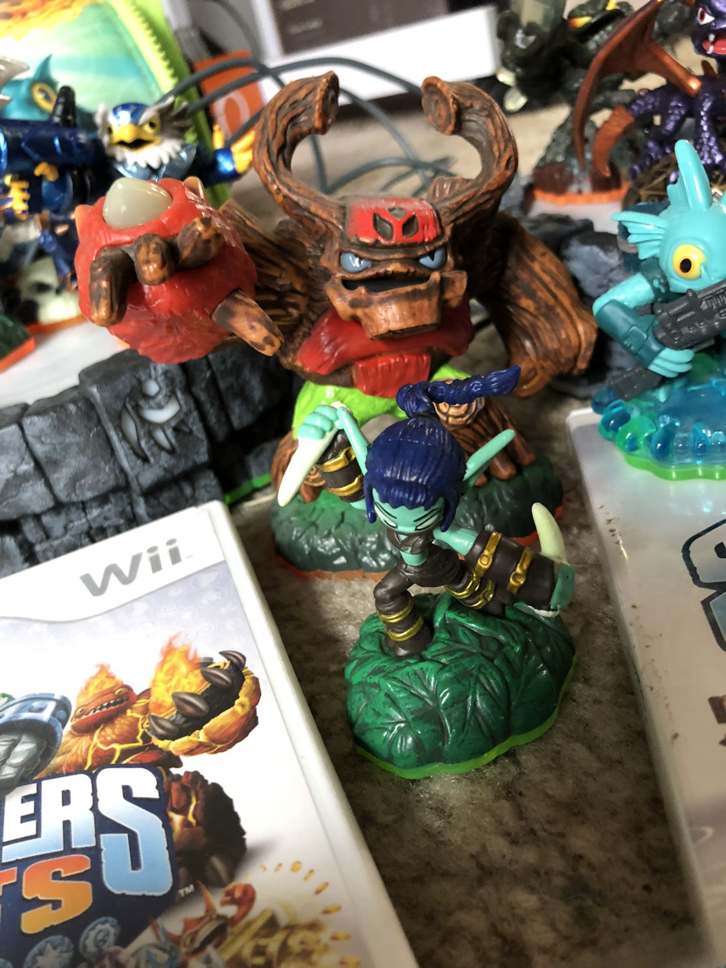 Skylander Wii games and 16 characters with carrying case