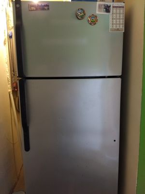 Large GE fridge WORKS stainless steel for Sale in Silver Spring, MD