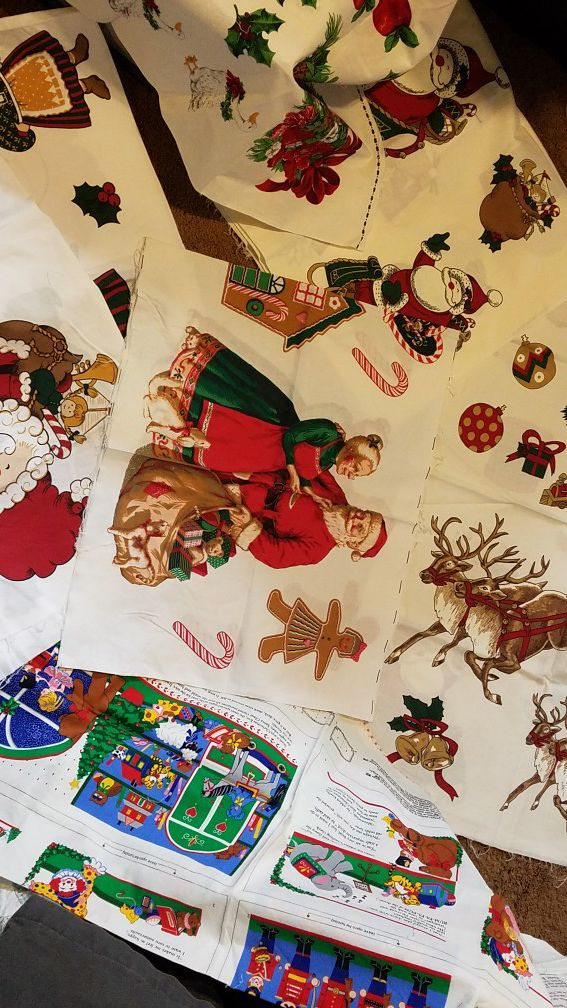 Vintage christmas fabric panels. 8 peices total. One is a fabric book.