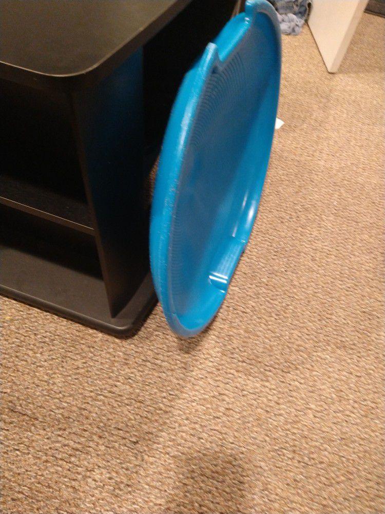 Saucer sled.