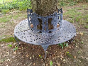Wrap around the tree 🌳 cast metal bench for sale for Sale in St. Louis, MO