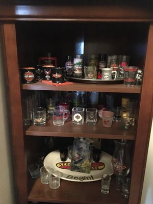 Harley Davison shot glass collection and wall art for Sale in Surprise, AZ