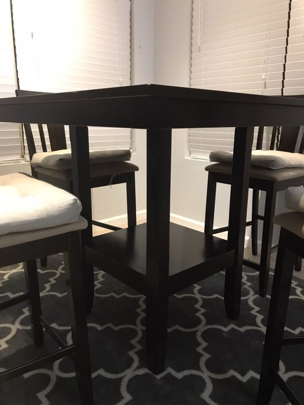 Raised dining table with 4 chairs - like NEW. Each chair comes with ...