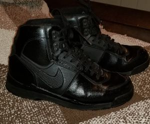 Black leather Nike boots kids (boys)7 (this shoe is perfect ladies that were 8s) for Sale in Hyattsville, MD