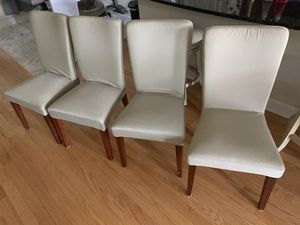 Photo Five pottery barn dinning room chairs with removable pottery barn slip covers
