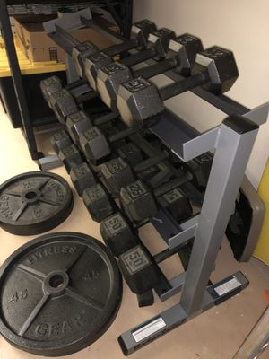 Photo Olympic weight set with handweights/rack