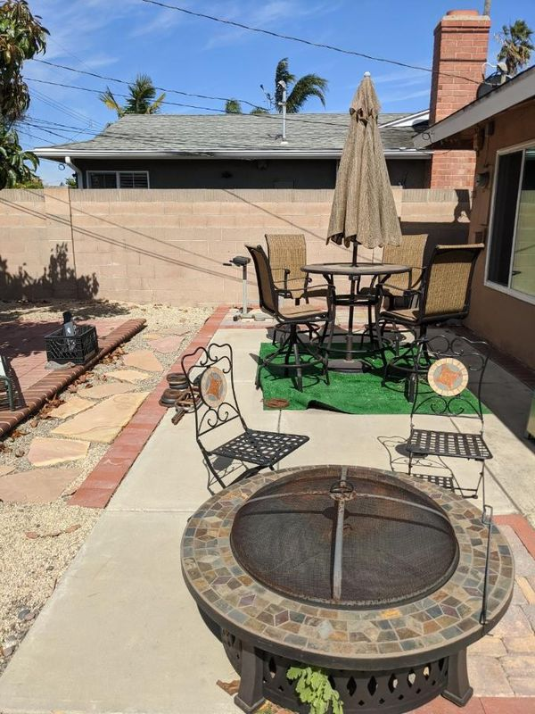Patio furniture with wood fire pit. for Sale in Huntington ...