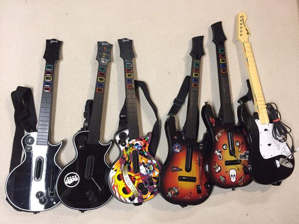 Xbox 360 Rockband Guitar Hero Wireless Wired Guitars for Sale in  Hurstbourne, KY - OfferUp