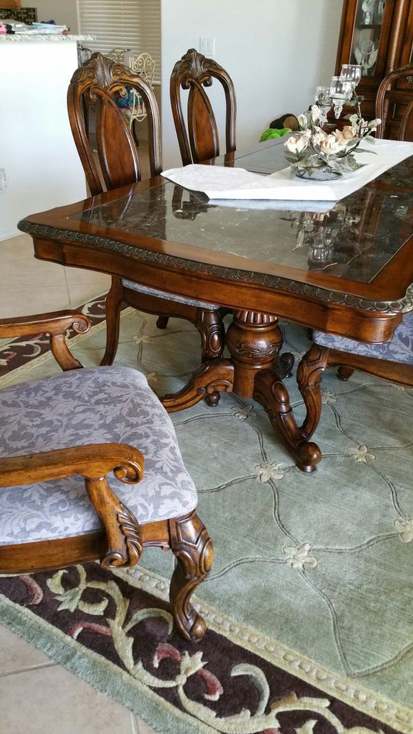 Kathy Ireland Carved Wood Dining Room Table Faux Marble Top Two Captains Four Side Chairs Grey Fabric Seats 44x84 Nice Condition For In