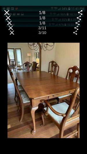 Photo Beautiful high end dining room set, 4 piece custom table pads,2 extensions, 8 chairs ,drawers built into table