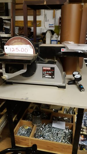 Photo Craftsman sander I'm rolling table with two rolls of sandpaper