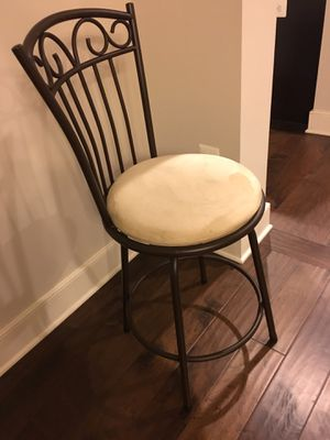Set of three brown metal swivel bar stools. Normal wear ( good condition)Beige color. $55 for Sale in Chantilly, VA