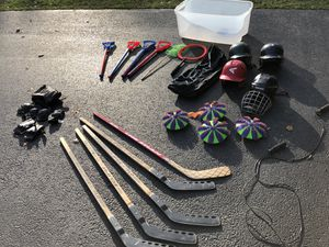 KIDS SPORTS AND GAMES ITEMS!! HELMETS, HOCKEY STICKS .. EVERYTHING YOU SEE FOR $30 for Sale in Glenview, IL