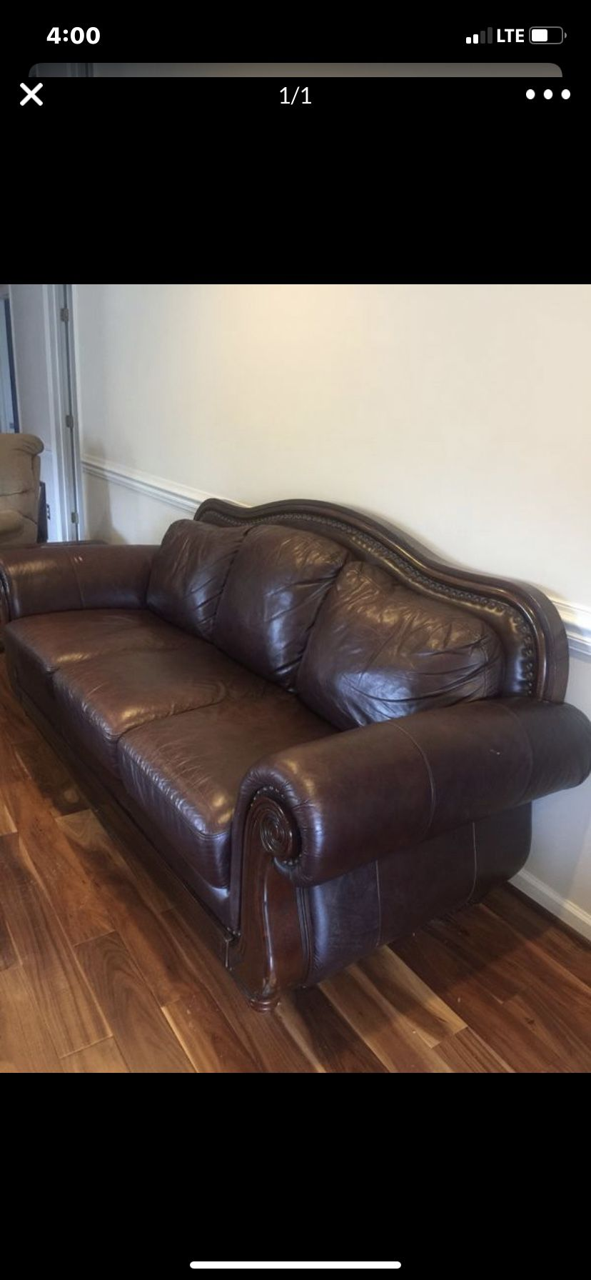 Dark brown studded leather & wood couch