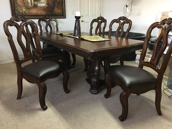 formal dining room table with 6 leather chairs (furniture) in peoria