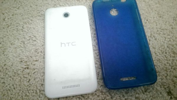 White Htc Opcv1 Smartphone W Blue Protective Case Cracked Screen