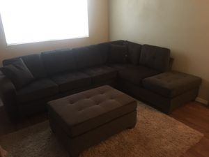 Brown sectional with ottoman for Sale in Austin, TX