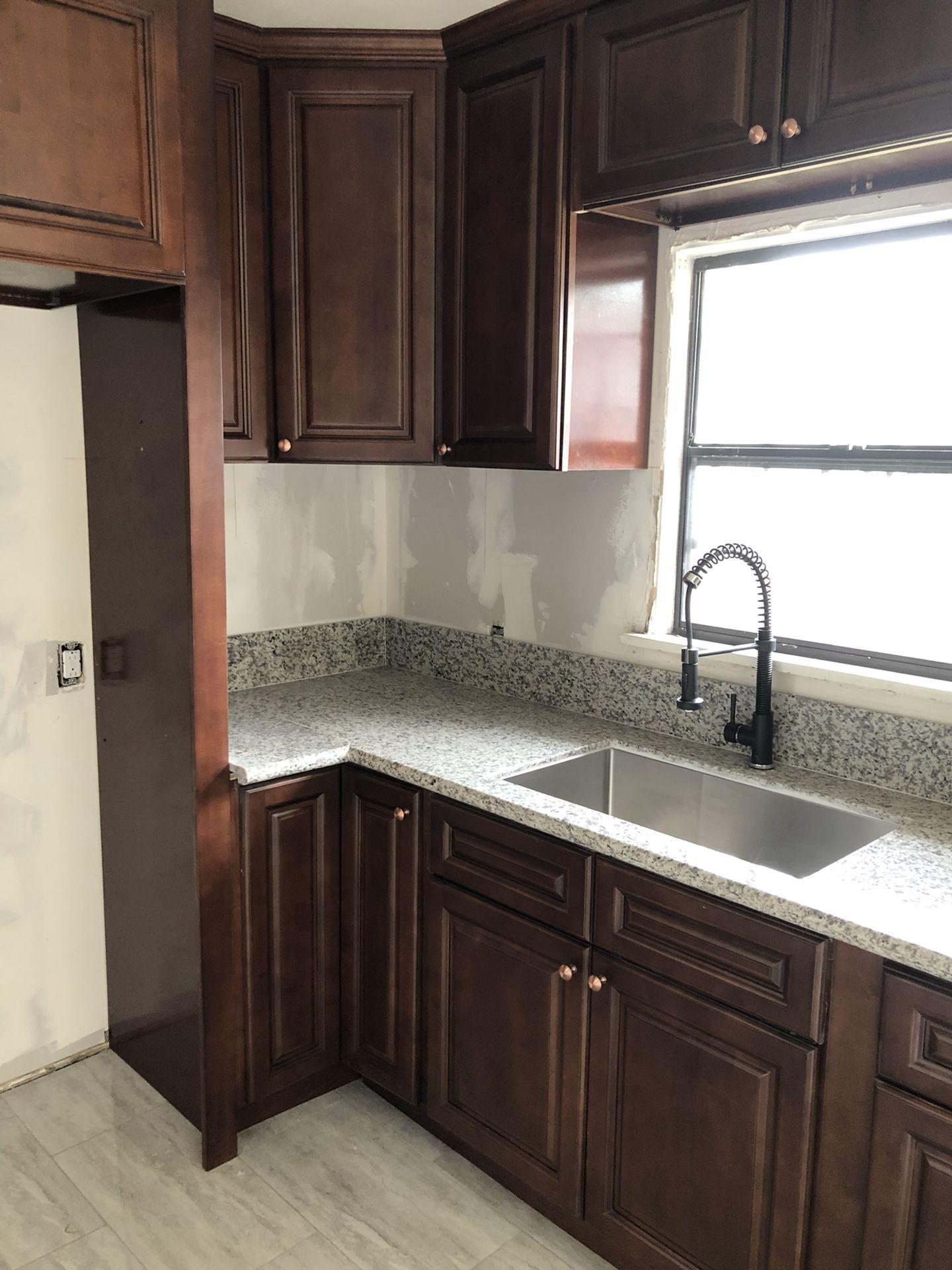 Cabinets, granite and quartz