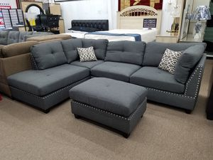 Brand new in stock grayish blue linen like fabric sectional with nailhead trim includes free accent pillows and ottoman for Sale in College Park, MD