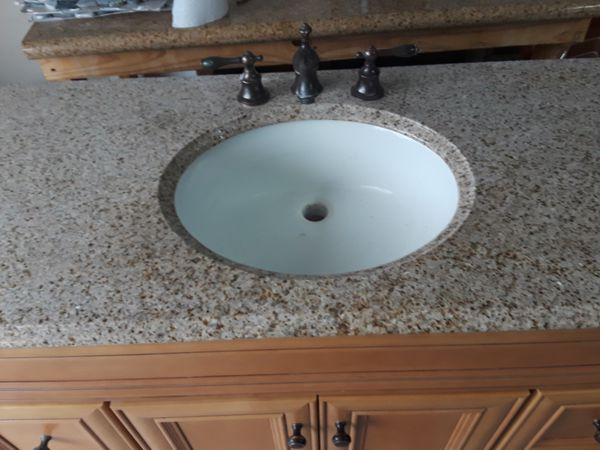 Bathroom Vanity With Granite Counter Top And Faucet In Excellent