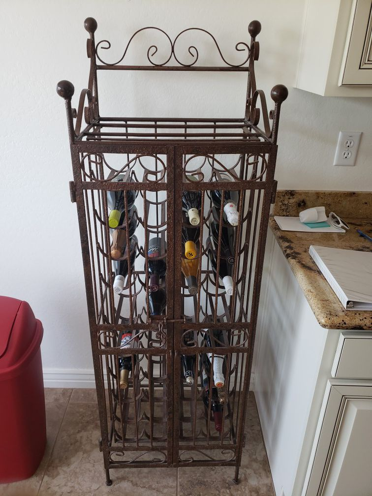 Rod iron wine rack. Sturdy and heavy
