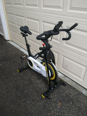 Photo Stationary exercise bicycle, spin bike