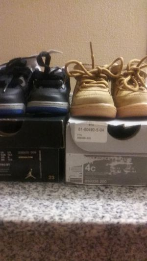 Both pair of shoes are name brand Nikes and Jordans boys size 4C in 3 C still in boxes for Sale in Clarksville, IN