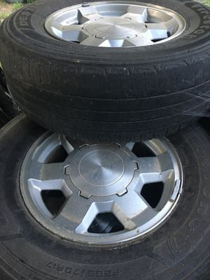 8 factory GM aluminum wheels and tires with caps and lugs. 4 are off 2005 GMC Yukon 17inch. 4 are off a 2002 Chevy Tahoe 16 inch. Tires are not great for Sale in Shipman, VA