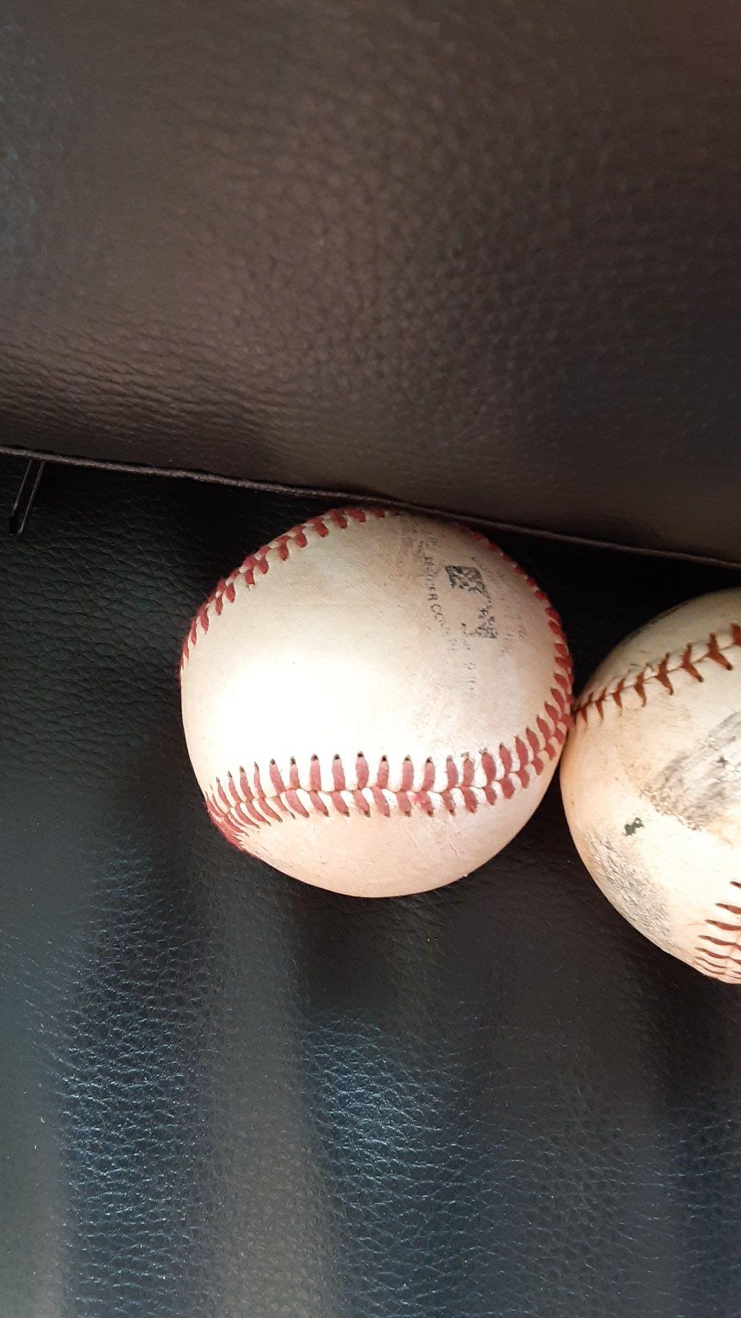 4 baseball balls
