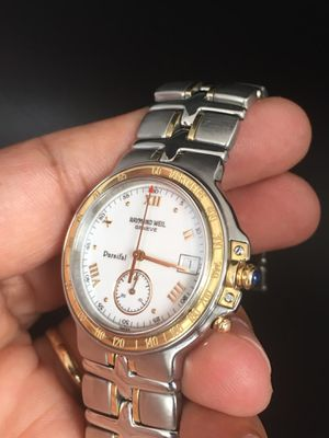 Photo Swiss made Raymond Weil Parsifal Tachymetre mens watch. PRV $$1895, quartz movement, 18K.gold and stainless steel,tachymeter pusher. 38m,box, papers.