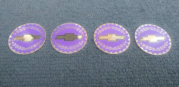 CHEVY BOWTIE WIRE WHEEL SPOKE RIM KNOCK OFF GOLD LILAC PURPLE SPINNER CHIP  INSERT SET SIZE 2 38 LOWRIDER for Sale in Chicago, IL - OfferUp