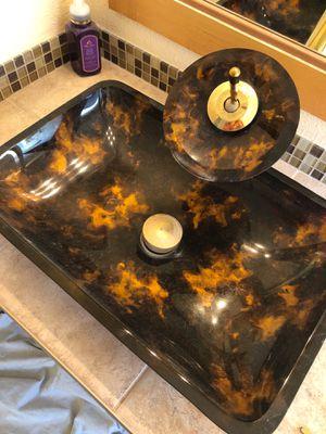 Photo Vessel sink w/ waterfall faucet