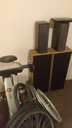 Photo I have two 24 inch rims and tires 26-inch rims for speakers a DVD player and a workout bike