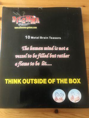 10 piece Brain teaser metal games by Dilemma metal gadgets puzzles fidget game for Sale in Arlington, VA