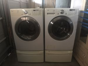 Photo LG Tromm Washer and Gas Dryer Front Load With Pedestals Barely Use Good Maintanance Very Clean Working Great