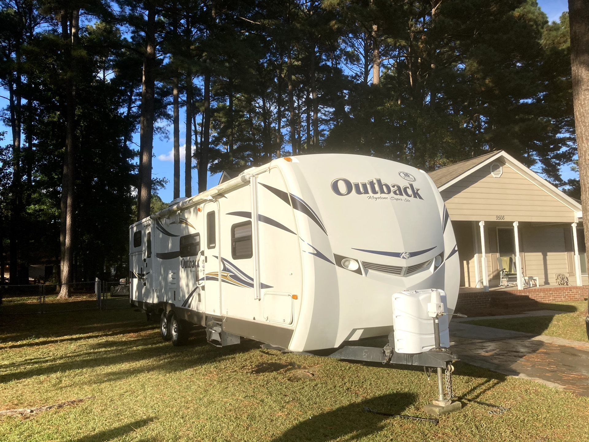 Photo 2011 313BH Outback by Keystone UltraLite 10th Anniversary Edition travel trailer