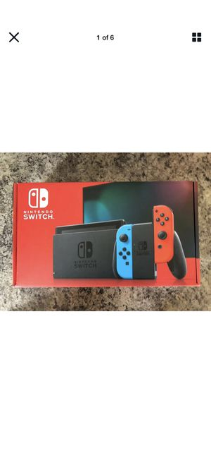 Photo *New* Nintendo Switch Console - Neon Red and Neon Blue Joy-Cons