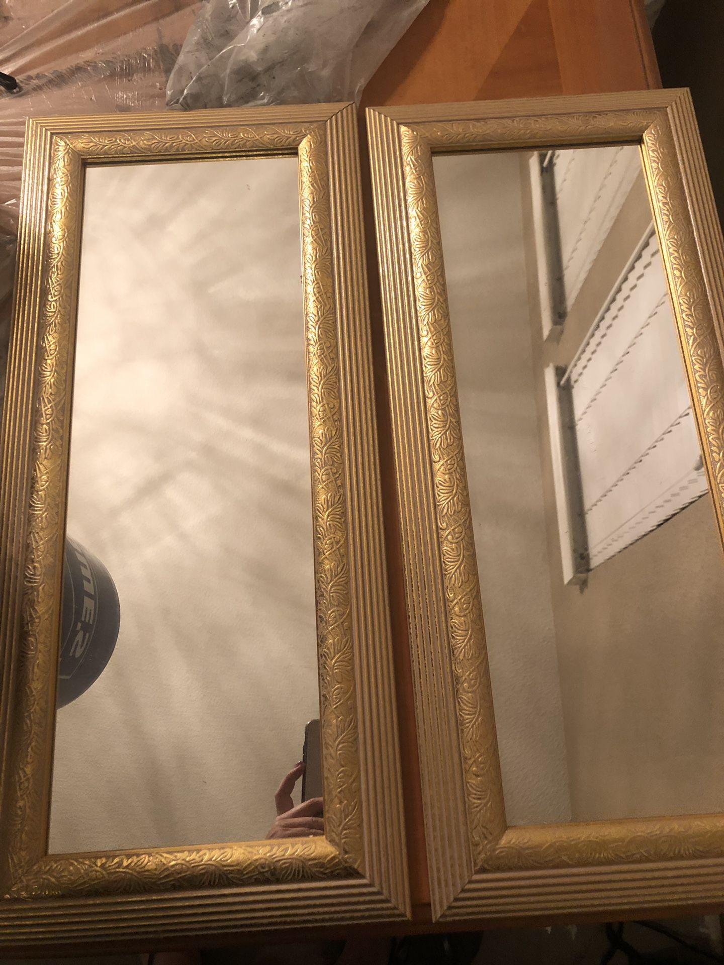 2 gold mirrors