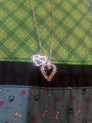 Photo 925 Silver and Genuine Diamond Accented Heart Shaped Pendant and 925 Love Charm on a 925 Silver Chain Necklace