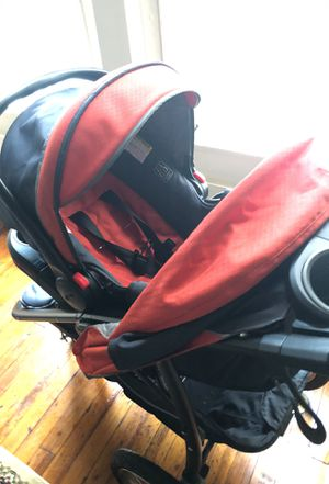 Graco stroller orange gray and black with car seat never really used great for new born for Sale in Baltimore, MD
